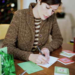 2e7e3-woman-writing-thank-you-card-250255b1255d